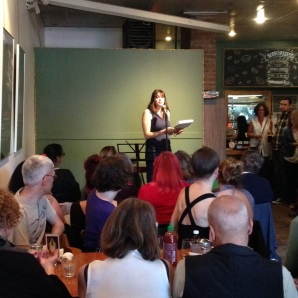 Yours truly addressing the amazing crowd at Heartwood Cafe. Photo by Caitlin Press.